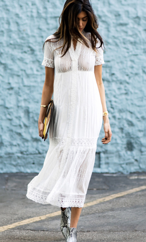 White lace makes the perfect summer apparel! Kelsey Taylor White looks ready for the sun in this gorgeous flowing dress, worn with faux snakeskin ankle boots and a cute clutch. Dress: Bardot Valentina, Bag: Madison Harding, Bracelets: Coordinates Collection, Shoes: Aska Lott.