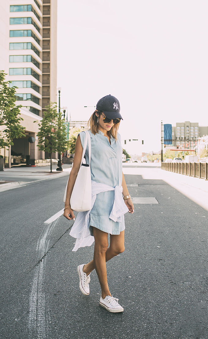 Ready for summer? Christine Andrew certainly is in this chambray dress, striped shirt around her waist, Converse and cap.