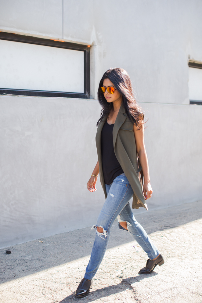 It has got to be sleeveless and it has got to be khaki. Via Sheryl Luke Vest: Asos, Jeans: Genetic denim, Shoes: Shellys