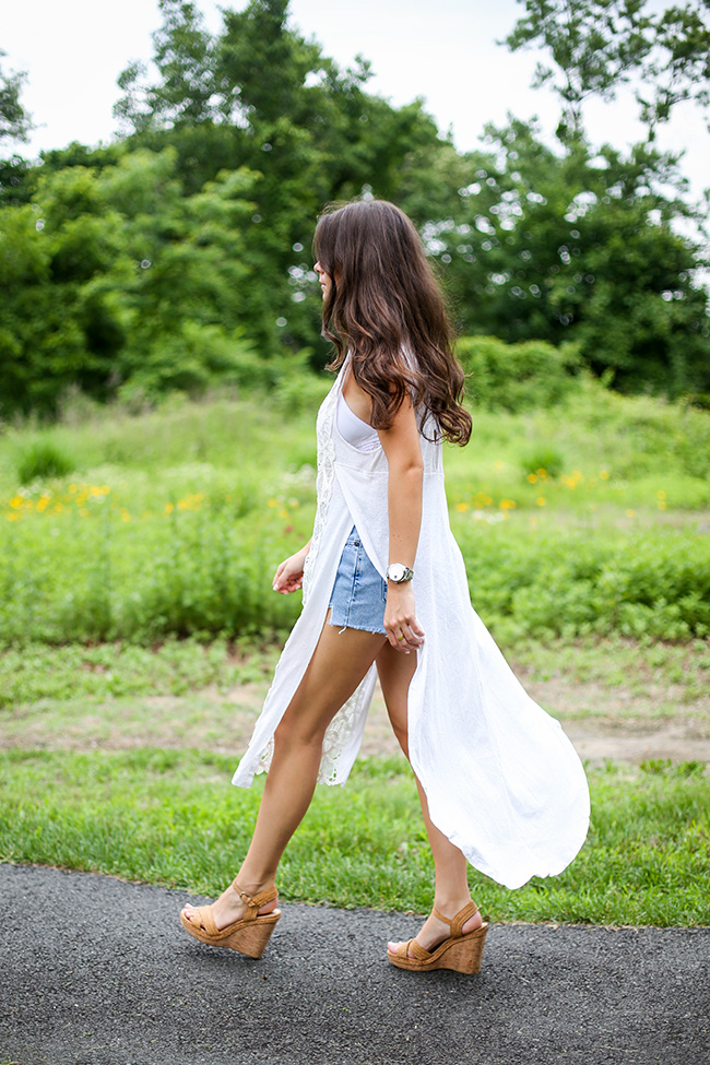 Summer is back. Keep it flowy and light. Via Liv Micheli Tunic: Free People Tunic, Shorts: Levi's, Bralette: Cosabella, Sandals: Stuart Weitzman