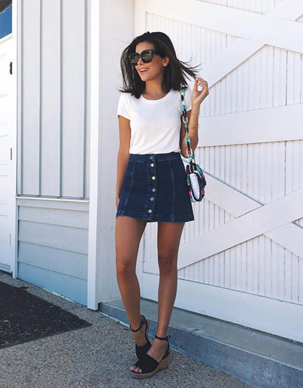Sazan Barzani is wearing a button front denim mini skirt from Topshop - These Denim Skirt Outfits Will Make You Become A Headturner - Just