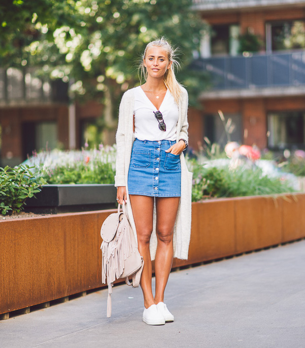 Jannie Deler is wearing this Summers most worn item, the button front denim  skirts paired - These Denim Skirt Outfits Will Make You Become A Headturner - Just