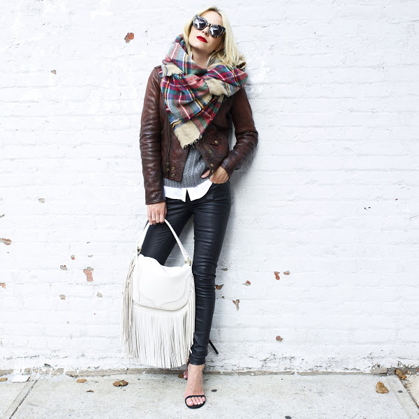 Statement scarves can really brighten up an outfit. Pair yours with a vintage leather jacket and leather trousers to recreate Blair Eadie's look. Jacket/ Trousers: Polo Ralph Lauren.