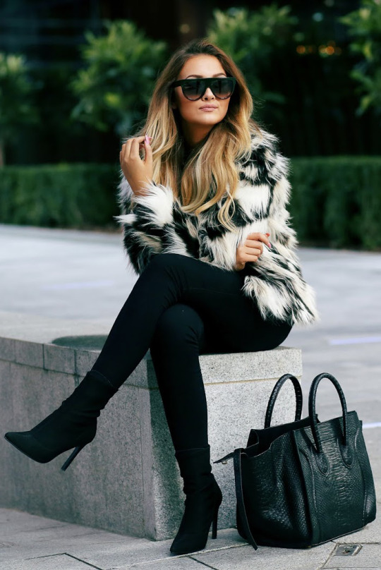 Fur coats are always a win; go bold with a statement piece like this one from H&M. Via Thatpommiegirl.com. Jacket: H&M.