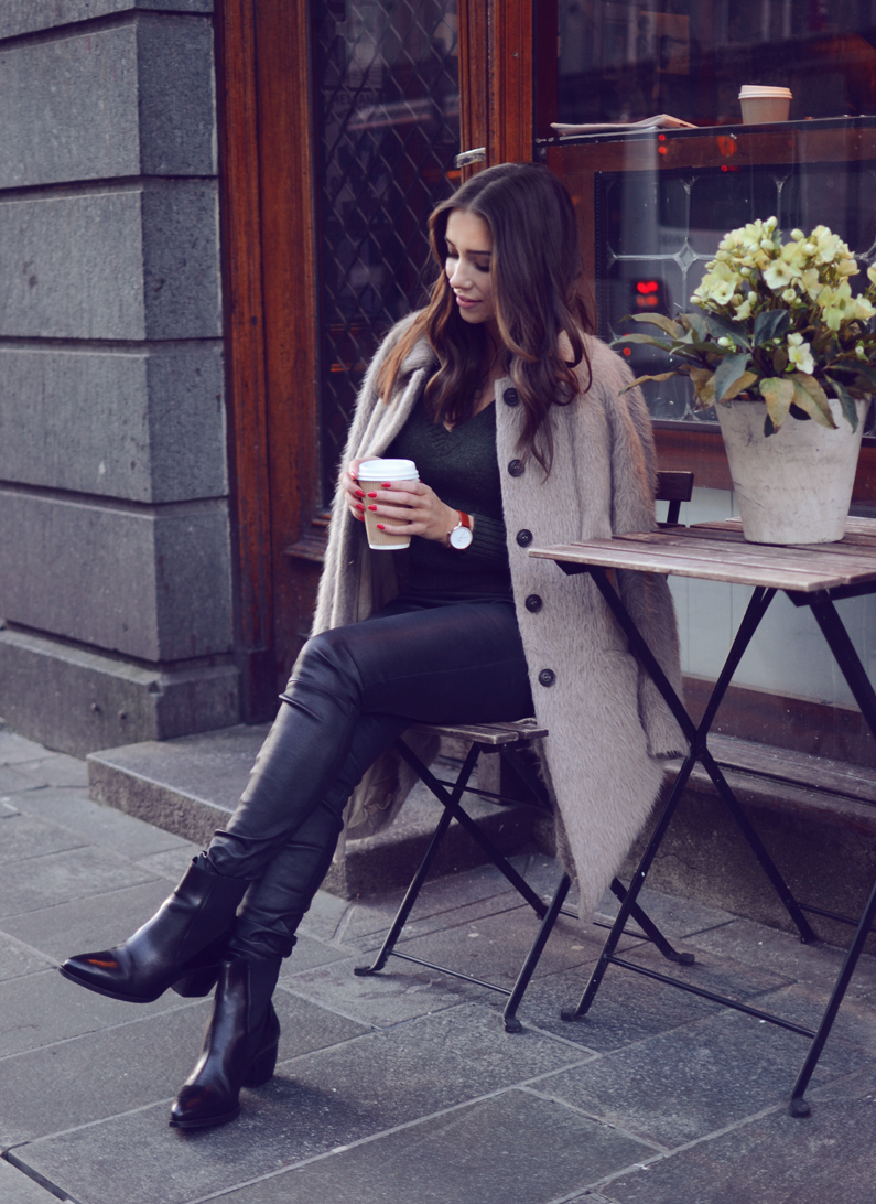 Emilie Tommerberg wears a lush fur jacket over leather trousers and ankle boots. Coat: Riccovero, Sweater: Benetton, Trousers: Malene Birger, Shoes: Riccovero.