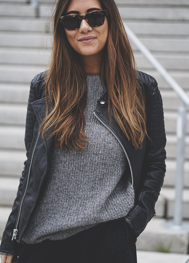 Michelle Nielsen is rocking monochrome. We love this grey knitted jumper and leather jacket combo. Brands Not Specified.