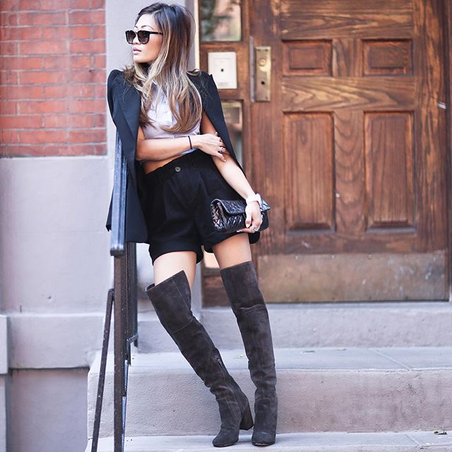 Shai Chung shows us how to wear over the knee boots with shorts as she pairs the two with a boyfriend blazer and cute clutch. Boots: Via Spiga.