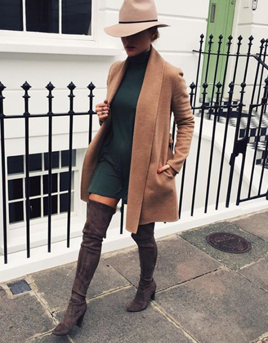 Caroline Louis wears a beige coat with a turtle neck mini dress and over the knee boots. Brands not specified.