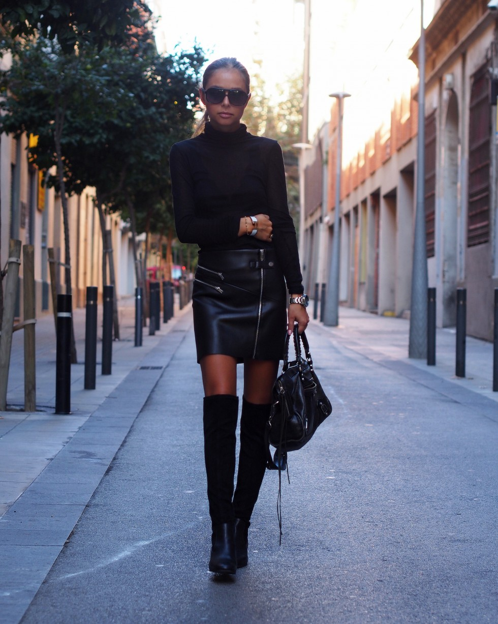 Maria kragmann wears a pair of over the knee boots with a leather mini