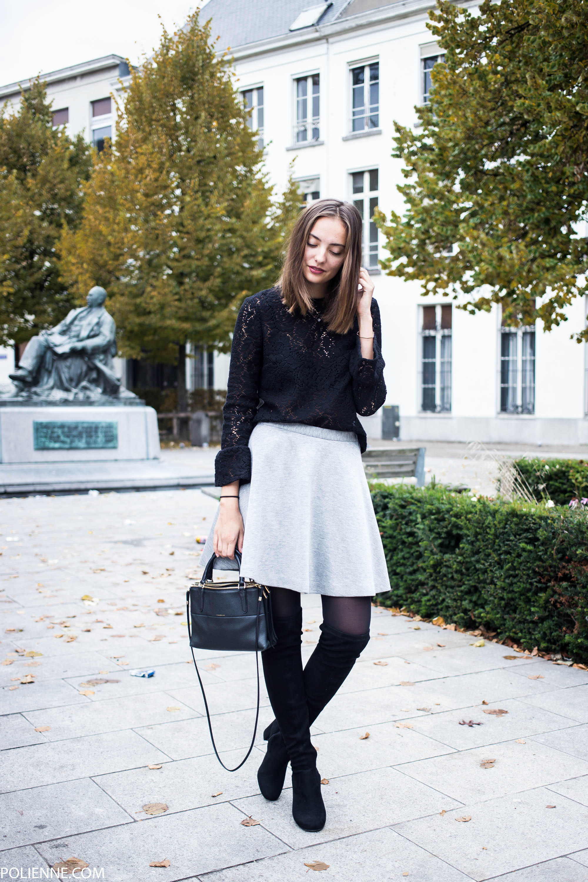 Over the knee boots look great worn with a simple A line skirt like this grey number worn by Rosanna van Billie-Rose. Brands not specified.