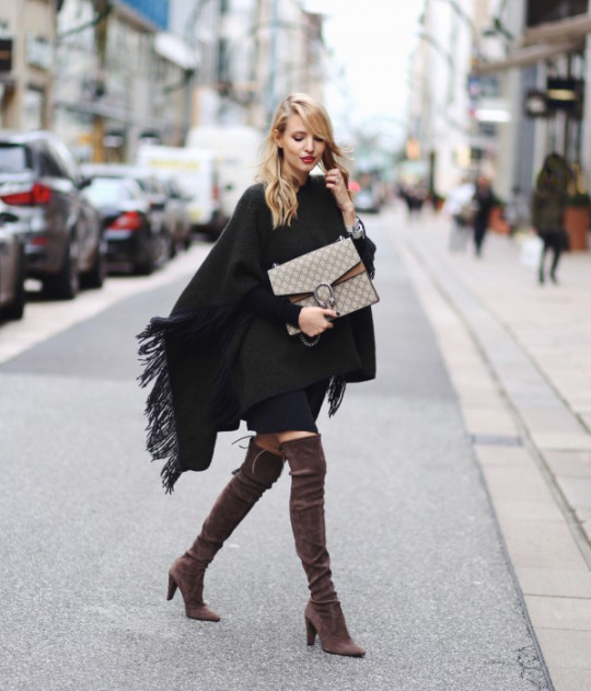 The poncho trend is another which goes brilliantly with over the knee boots. Leonie Sophie wears a fringed green poncho with patent brown boots and a gorgeous Gucci bag. Poncho: Closed, Boots: Stuart Weitzmann, Dress: Ikks, Sweater: All Saints, Bag: Gucci.