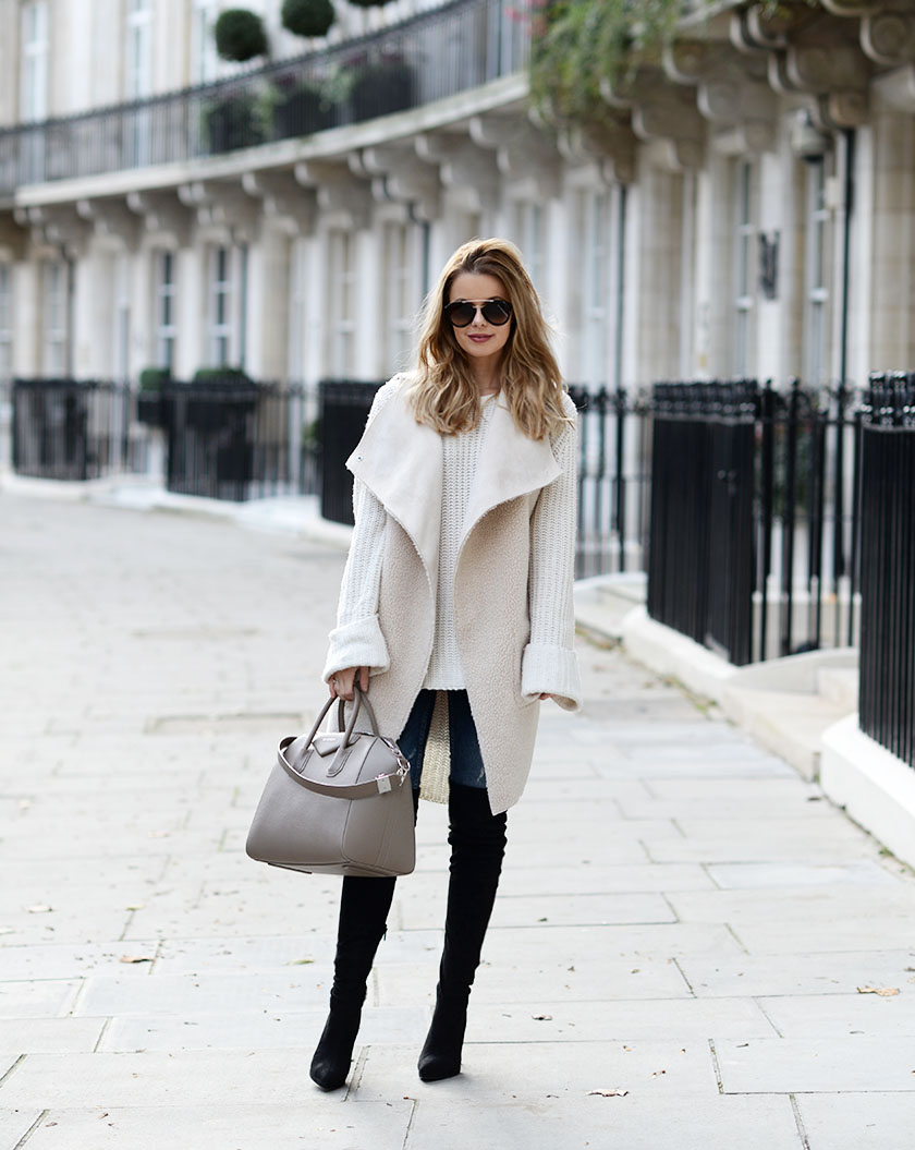 These boots look sleek and sophisticated worn with Annette Haga's sheepskin waistcoat and knitted extra long sleeved jumper. Get yourself a similar shearling item to join the trend. Vest: By Lene Orvik, Jumper: One Teaspoon, Jeans: Gina Tricot, Bag: Givenchy, Over knee-boots: Asos, Sunglasses: Prada.