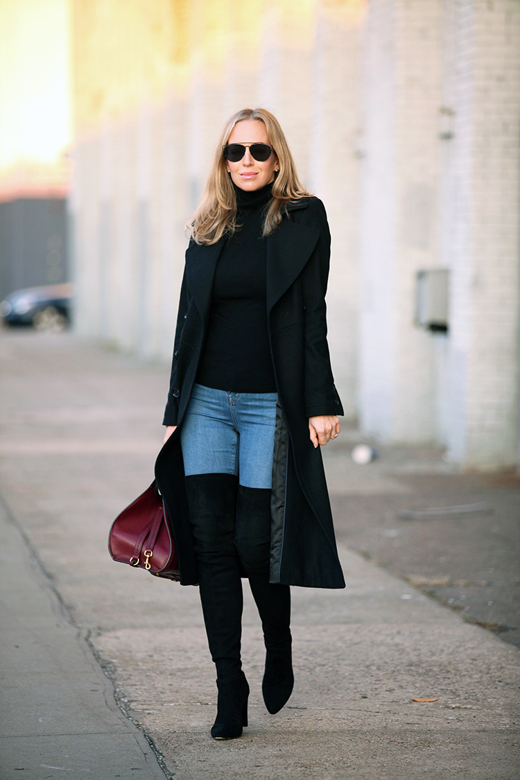 These thigh high black over the knee boots look ultra sophisticated worn with tight denim jeans, a black polo neck, and a matching black overcoat. Via Helena Glazer. Coat: French Connection, Turtleneck: Nordstrom, Denim: Topshop, Boots: Stuart Weitzman, Sunglasses: Dior, Bag: Gucci.