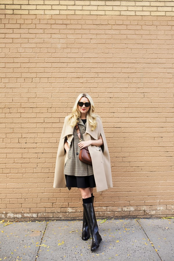 Blair Eadie wears the cape trend, layering a classic tweed cape and a beige overcoat. Camel Cape: Carven, Plaid Cape: Topshop, Boots: Jenni Kayne, Dress: Tibi. Bag: Gucci, Sunglasses: Prada.