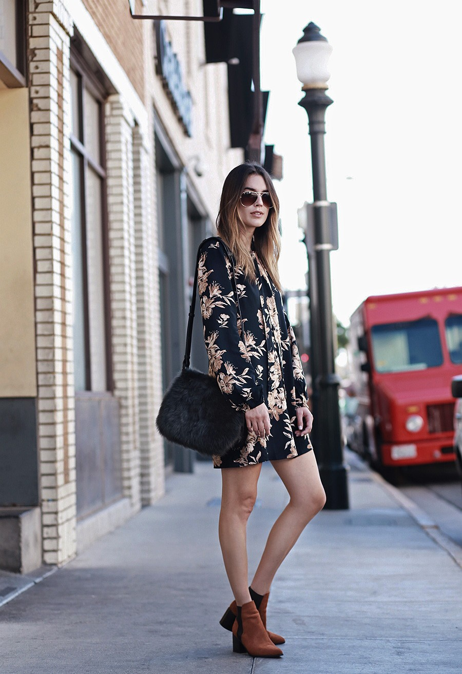 Brittany Xavier wears a cute long sleeved floral print dress and terracotta ankle boots. Dress: Threadsence, Booties: Aldo, Bag: Banana Republic.