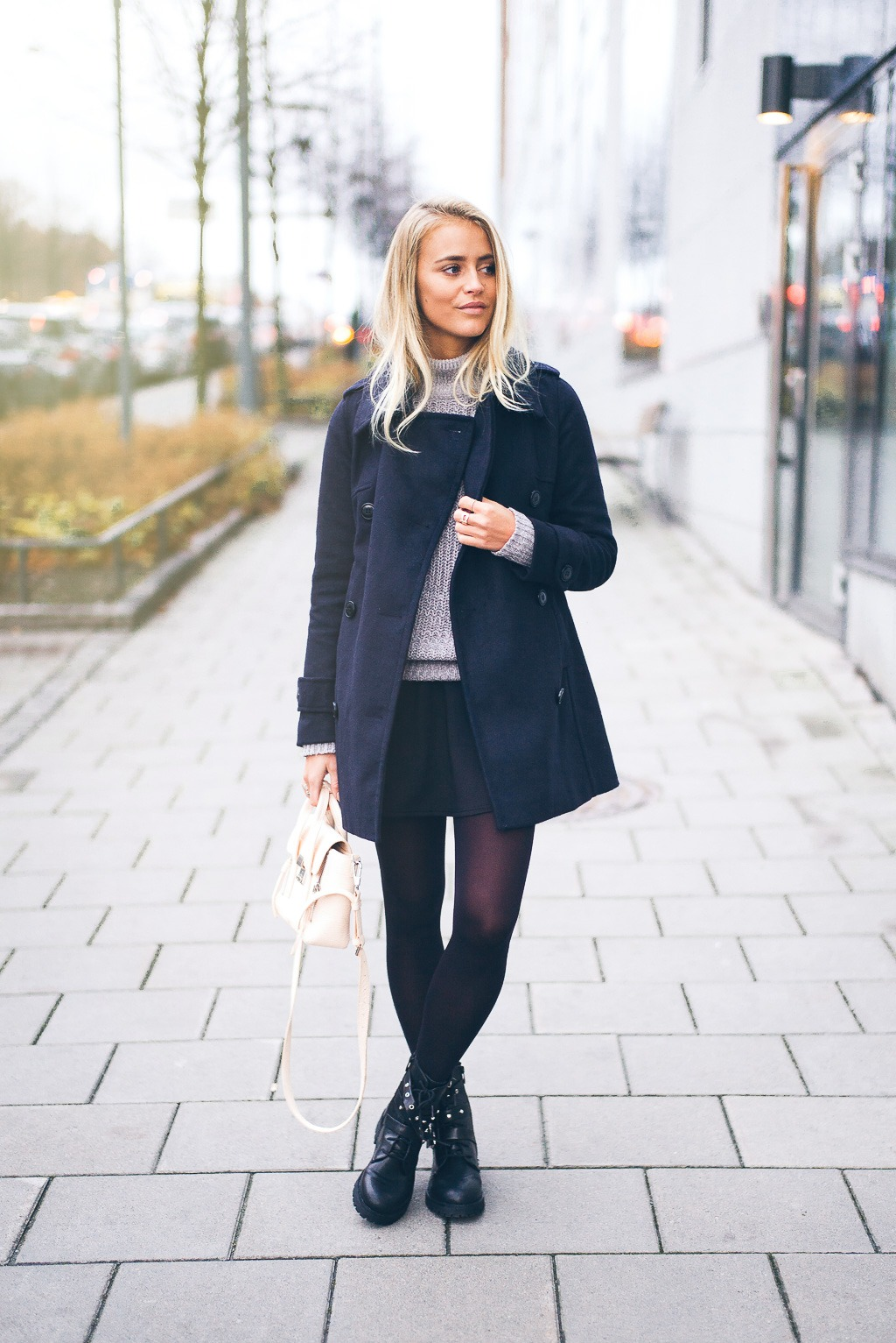 Combat boots can add edge and a tough quality to your everyday outfits. Wear a pair with a skirt and tights to steal Janni Deler's style. Jacket: Lindex, Sweater: NLYtrend by Janni, Bag: Phillip Lim, Shoes: Nilsson.