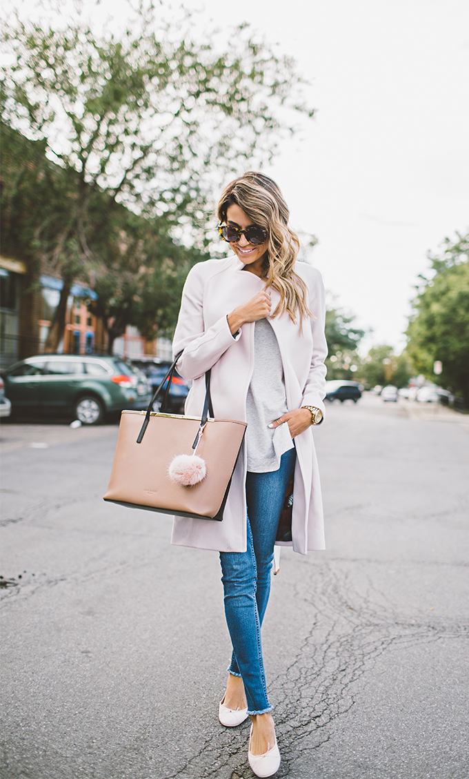 Christine Andrew wears a pair of stylish skinny jeans and a pale pink coat; a cute and easy fall look. Coat/Tee: Blush Wool, Jeans: Ted Baker.