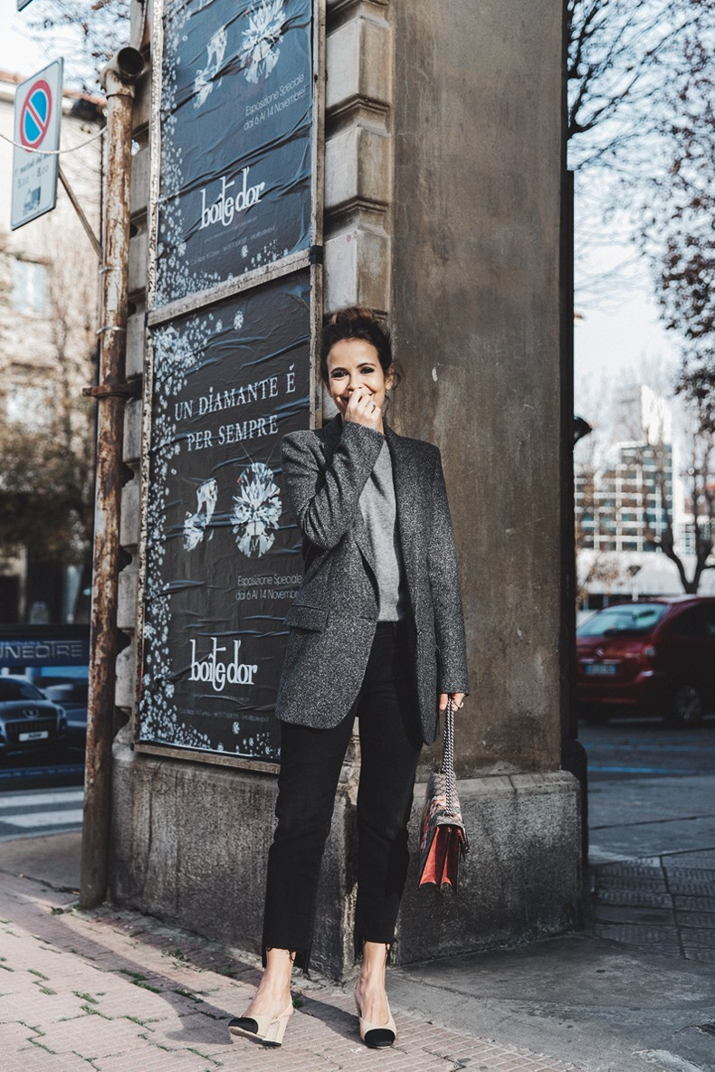 Wearing a blazer rather than a coat can both smarten and add quirkiness to your outfit. Sara Escudero looks ready for work or play in a grey fuzzy blazer and slacks. Blazer: Zara, Jersey: Old, Jeans: Levi's, Bag: Gucci x BrunaRosso, Shoes: Chanel.
