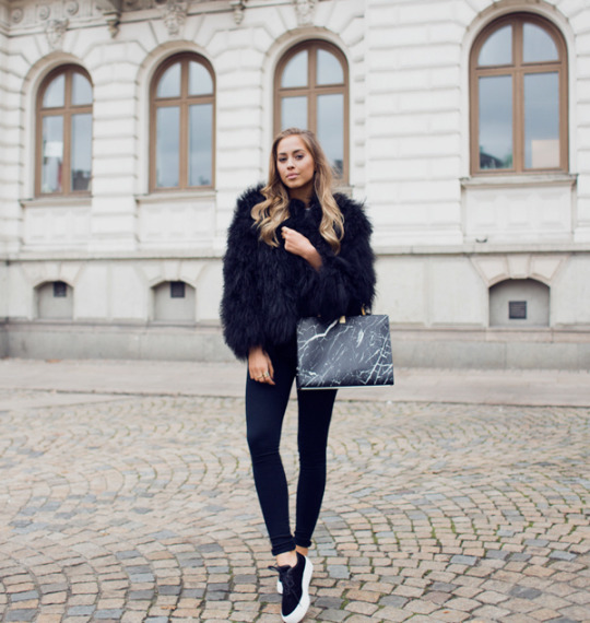 Not only will a fur coat keep you warm, but it will also look stylish with almost any outfit. Via Kenza Zouiten. Jacket: Pellobello, Jeans: Nelly.com, Shoes: Jennie-Ellen, Bag: Balenciaga.
