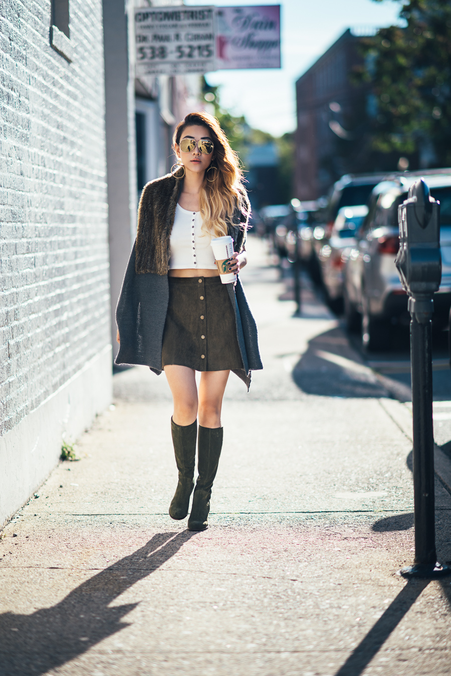 Button front skirts are all the rage this fall. Via Not Jess Fashion. Boots: SkinnyCalf, Fur Vest: Foxiedox, Top/Skirt: Forever21.