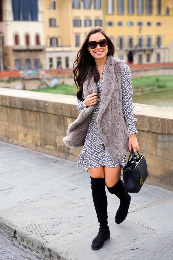 Over the knee boots are in this fall. Wear yours with a cute mini dress and a faux fur vest like Kat Tanita. Dress: Tory Burch, Best: June, Boots: Stuart Weitzman.