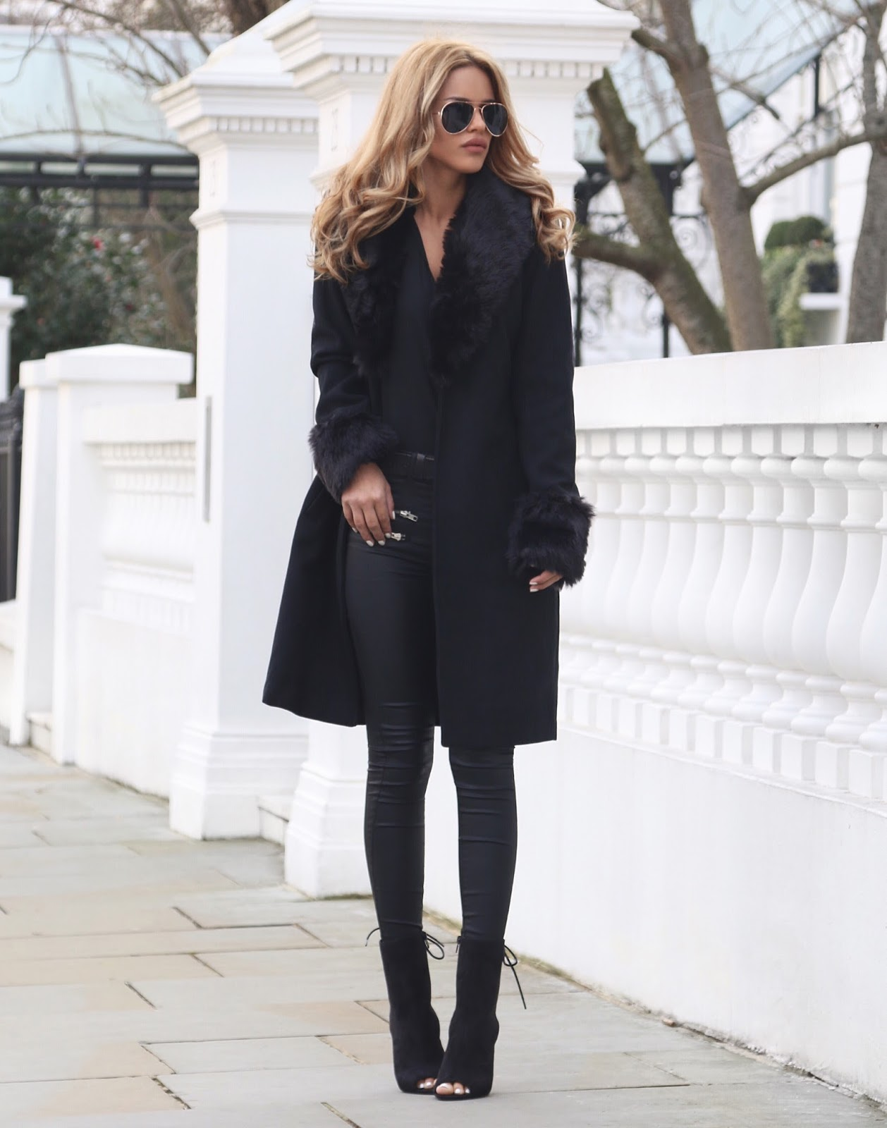 Wear a faux fur collar with an all black outfit to steal Nada Adelles glamorous monochrome