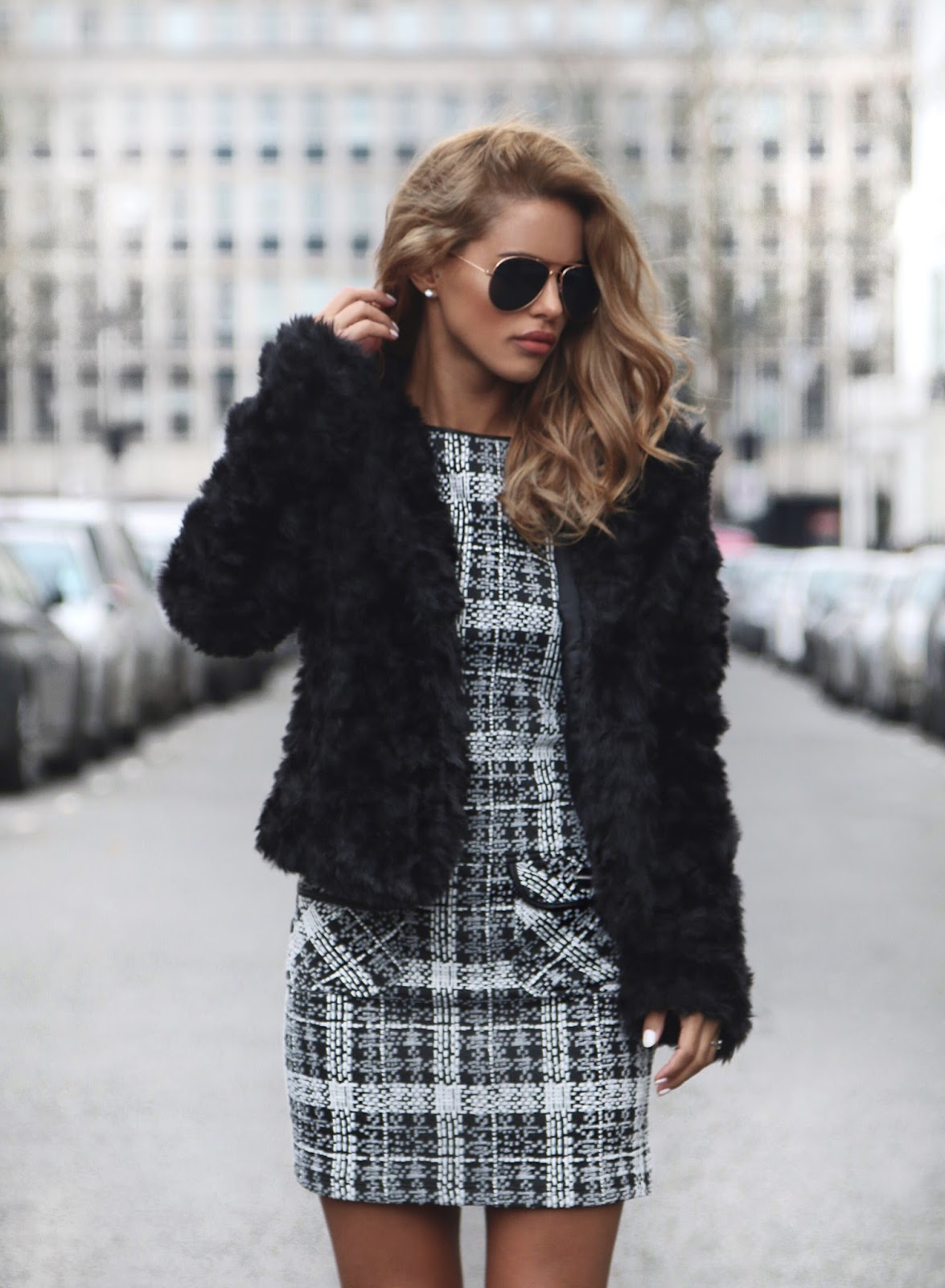 Nada Adelle looks ultra glam in this monochrome check mini dress from Dorothy Perkins. To recreate this look, try wearing your own statement dress with a faux fur coat and simple ankle boots. Faux Fur Jacket: Quiz, Dress: Dorothy Perkins, Ankle Boots: Zara.