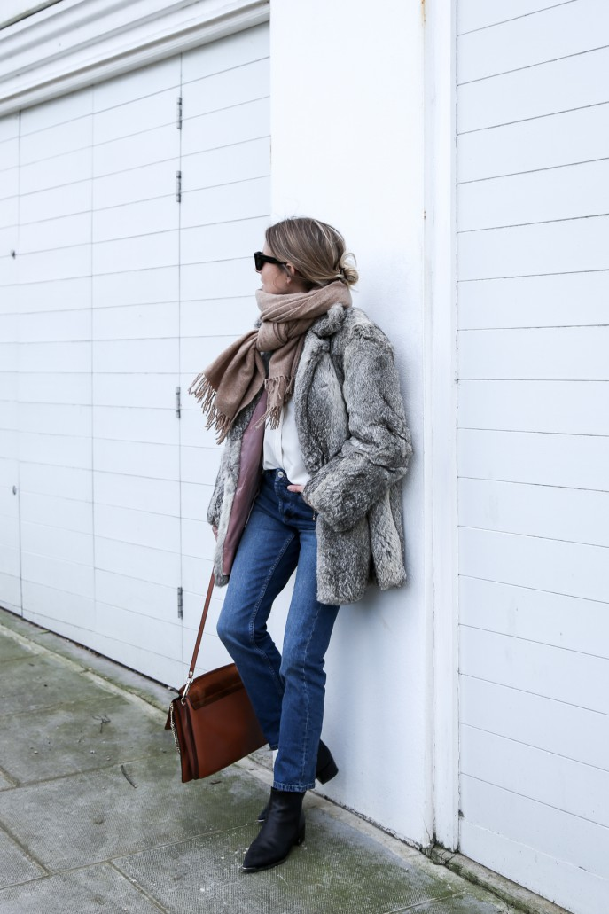 Lucy Williams is rocking a gorgeous vintage style here, wearing an authentic retro faux fur coat with straight leg denim jeans and an oversize scarf. This outfit is cute and individual, the perfect choice for this winter season! Jeans/Shirt: Topshop, Boots: Acne, Coat: Vintage, Scarf: Hush, Bag: Chloe.