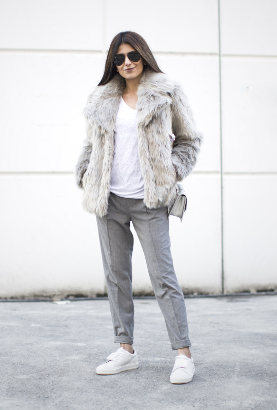 Laura Dittrich looks ultra cool in this individual outfit, consisting of grey slacks, white sneakers, and a statement faux fur coat. This style is perfect for an every day winter look! Coat: Oasis, Sneakers: Acne Studios, TrouserS: Zara, T-Shirt: Set.