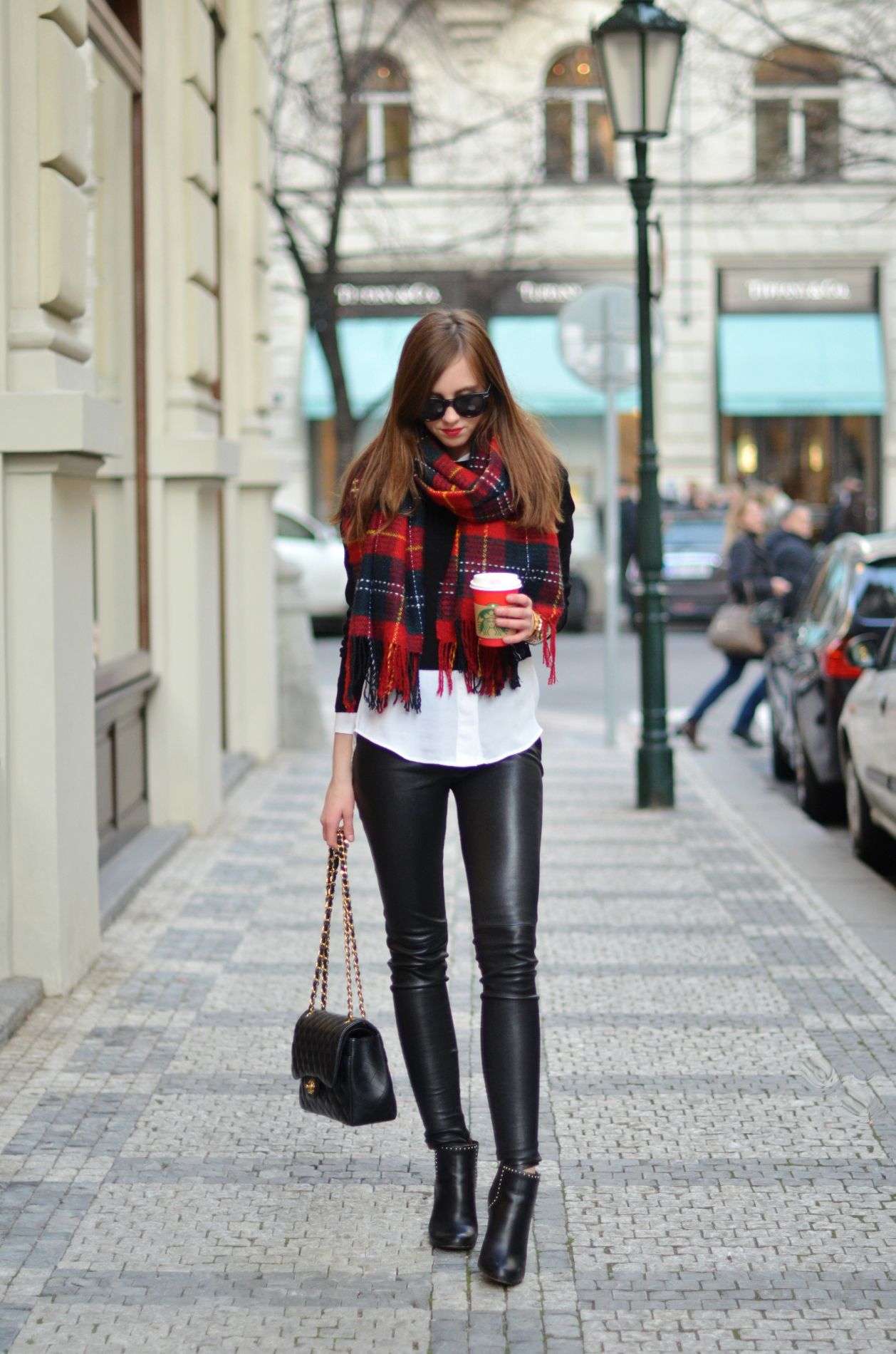 A statement tartan scarf is the ultimate must have winter item. Barbora Ondrackova brightens up an otherwise monochrome look with this cosy and stylish chunky scarf. Shirt: Topshop, Sweater: Mango, Leggings: Balenciaga, Boots: Givenchy, Bag: Chanel.