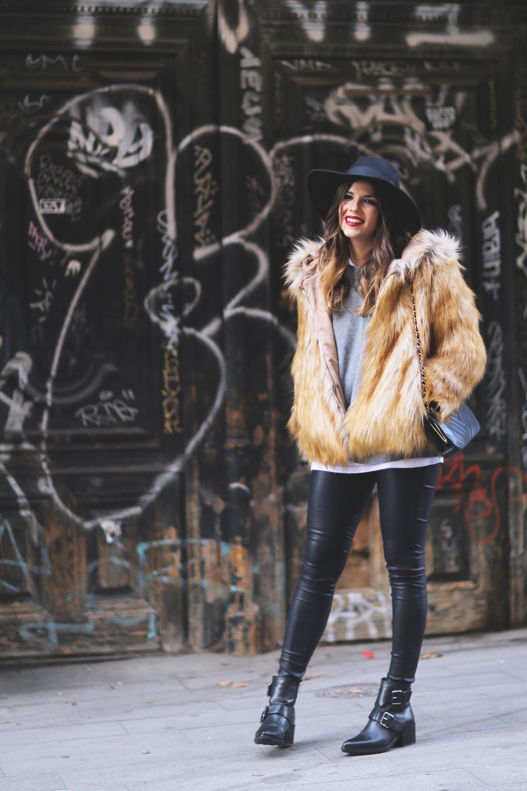 A statement faux fur jacket like this gorgeous tan number is the ultimate winter item! Natalia Cabezas wears the trend with leather leggings, a wide brimmed fedora, and edgy ankle boots; embracing all things retro. Coat/Leggings: Zara, Sweater: Uterqüe, Hat: Asos, Boots: Mango.
