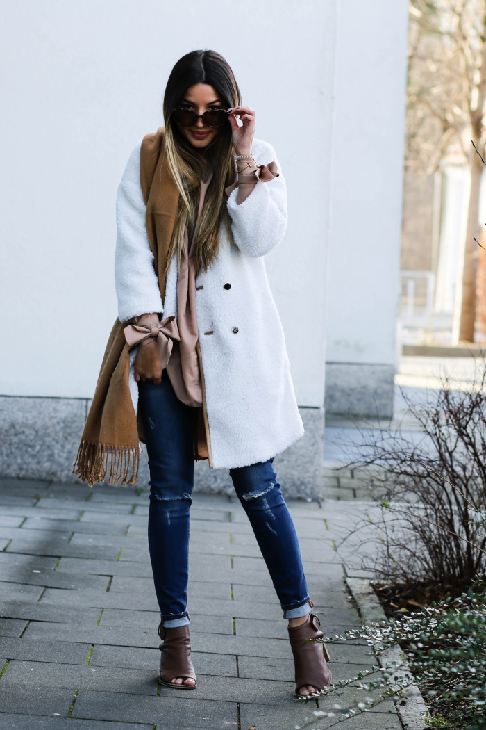Sheepskin is one of the absolute in trends this winter. Consuelo Paloma wears the style on a white coat, paired with ripped denim jeans and open toe heeled sandals; an easily achievable winter look. Coat/Shirt: Shein, Scarf: H&M, Jeans: Zara, Shoes: Asos.
