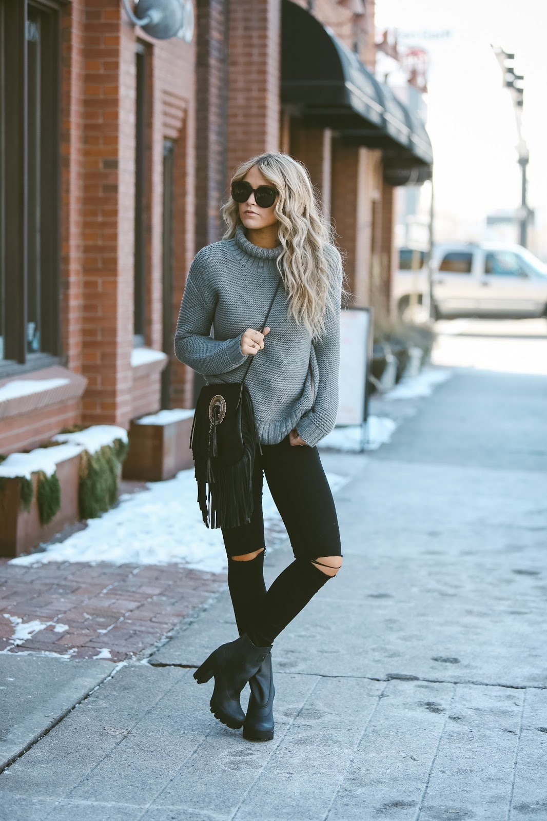 Wearing a knitted turtleneck sweater with jeans will always make for a cosy and chilled out vibe. Cara Loren wears the look with chunky platform ankle boots and a tasselled cross body bag; an easy and funky style. Sweater: Lululemon, Jeans: Urban Outfitters, Shoes: Shopbop.