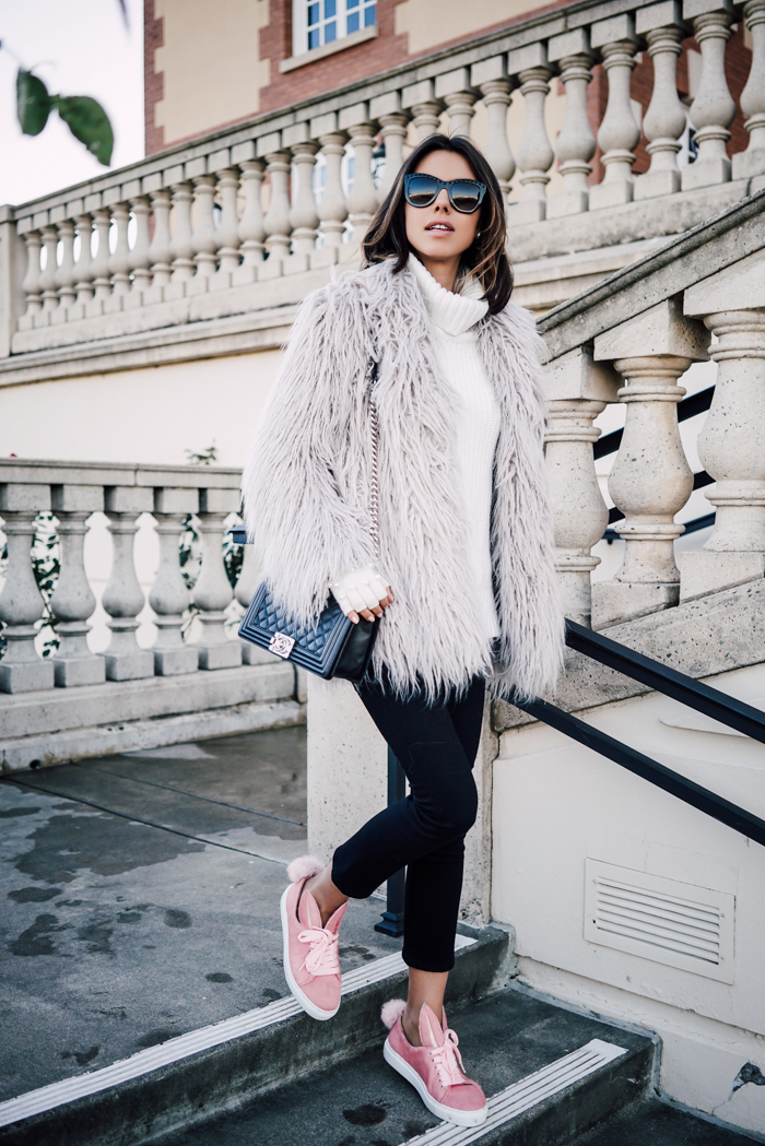 Dare to be unique this winter by trying items that are a bit more out there! This shaggy fur coat looks effortlessly cool paired with quirky pink bunny sneakers and cropped black jeans. Via Annabelle Fleur. Trousers: AYR, Coat: Glamorous, Sneakers: Minna Parikka, Bag: Chanel.