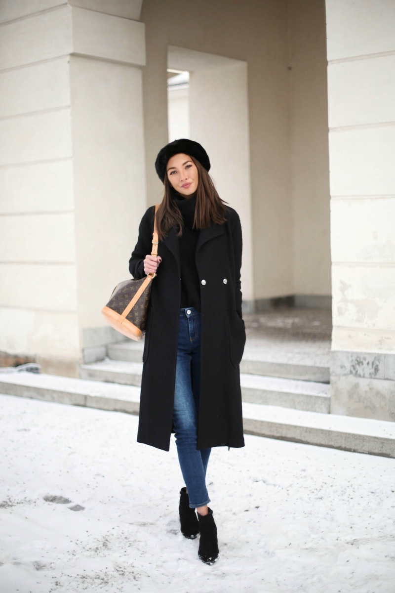 This cute winter outfit consists of classic denim jeans, a loose black turtleneck sweater, and a matching black hat and overcoat. Ideal for everyday wear, this look is stylish and sleek. Via Felicia Akerstrom. Jeans: Acne, Sweater: Lindex, Shoes: Aldo, Hat: Twist & Tango, Bag: Louis Vuitton.