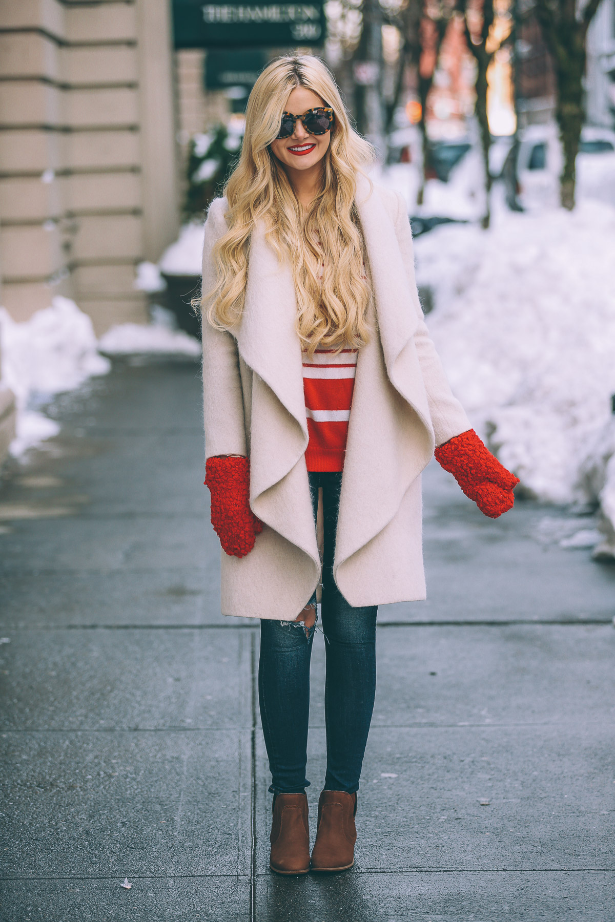Amber Fillerup Clark is rocking these adorable scarlet mittens; pairing them with a cream overcoat and a coordinated cream and red sweater for the ultimate winter look! Boots: DSW, Jacket: Veeda, Coat: Vince, Scarf: Asos.