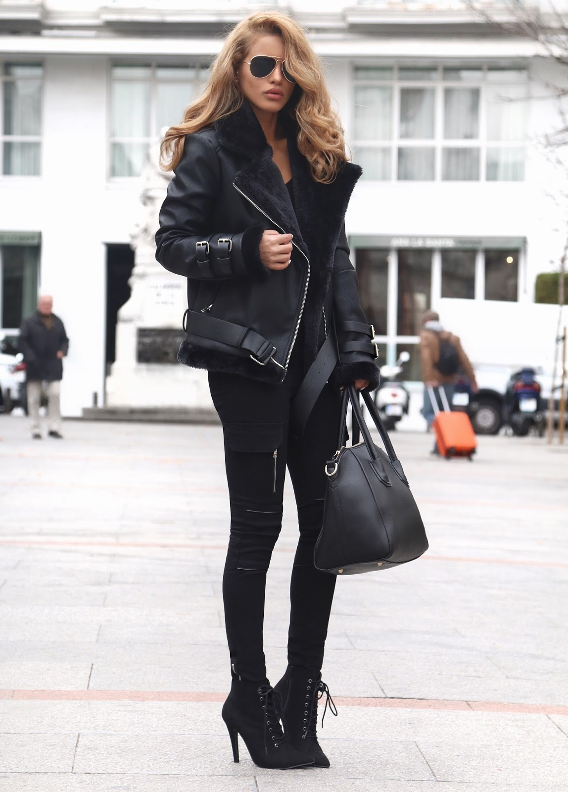 For a stylish winter look, we will always recommend the all-black trend! Easy and achievable, this style will look good with minimal accessorising. Via Nada Adelle. Shearling Biker Jacket: Maniere De Vo, Top: Topshop, Trousers: Maniere De Voir, Boots: River Island.