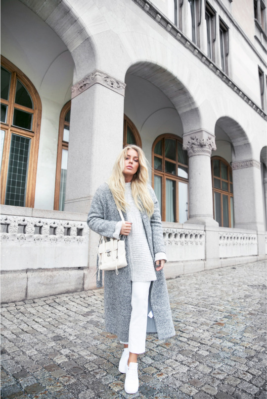 Looking for a cute winter style that won't break the bank? Try copying Angelica Blick's simplistic grey scale look by combining white culottes, a grey cable knit sweater, and a fuzzy grey maxi coat! Knit: Asos, Coat: Gina Tricot, Trousers: Topshop, Bag: Phillip Lim, Sneakers: Nike.