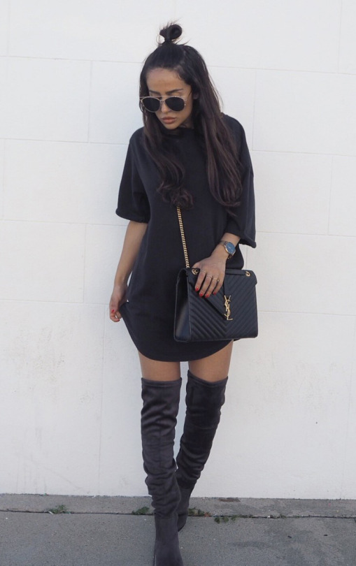 Kajsa Svensson is wearing an oversized tee in true minimalist style here, paired with over the knee boots and a YSL purse. Add some vintage shades to your look to make it more authentic! Tee/Dress: Bikbok, Boots: Want My Look, Bag: YSL.