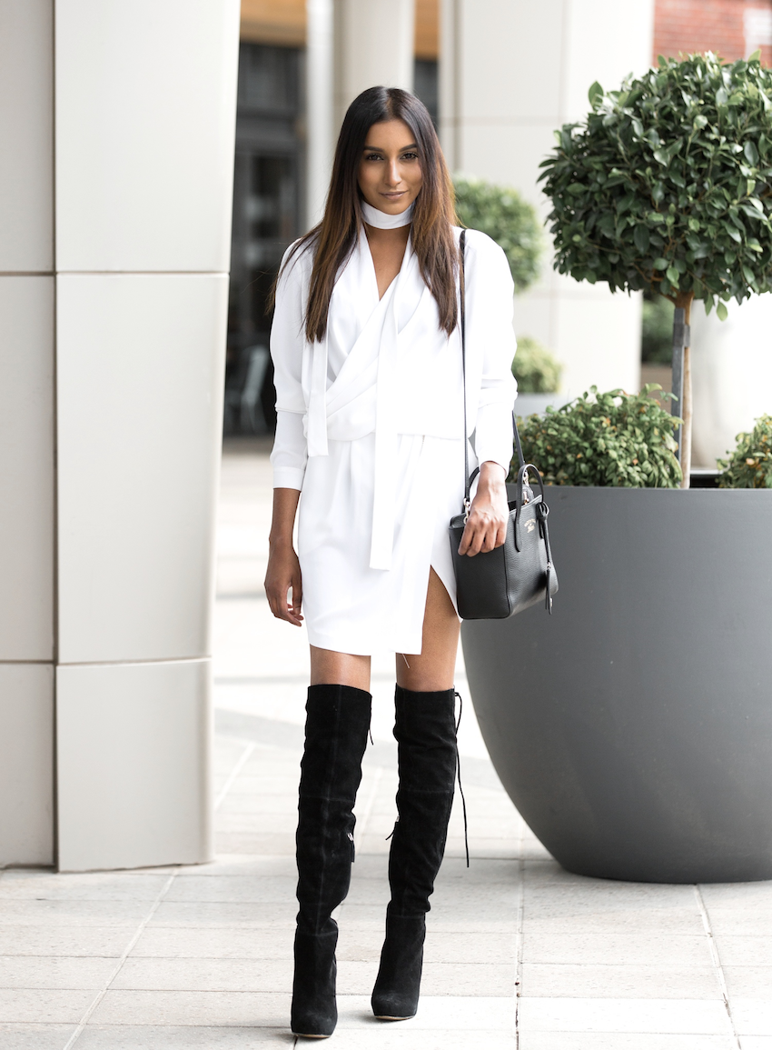 Vydia wears the thigh high boots style in collaboration with the monochrome trend here, pairing a pair of black boots with an all white wrap dress from MLM - the epitome of sophistication! Dress: MLM, Shoes: Siren.