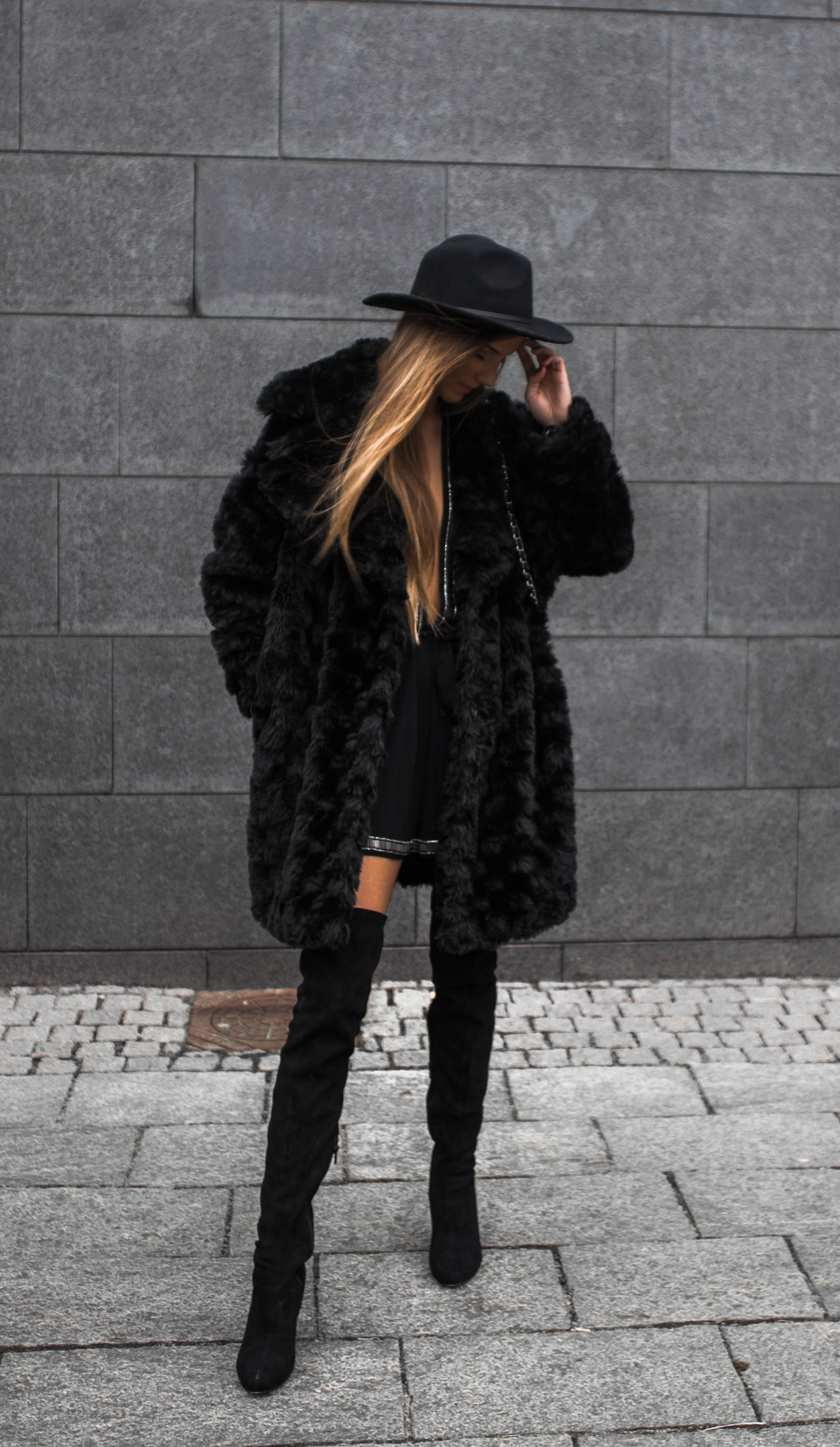 Sandra Willer looks ultra glam in this faux fur and thigh high boots outfit. Wear the look with a cute fedora or bowler hat to recreate this classy and feminine style. Brands Not Specified.