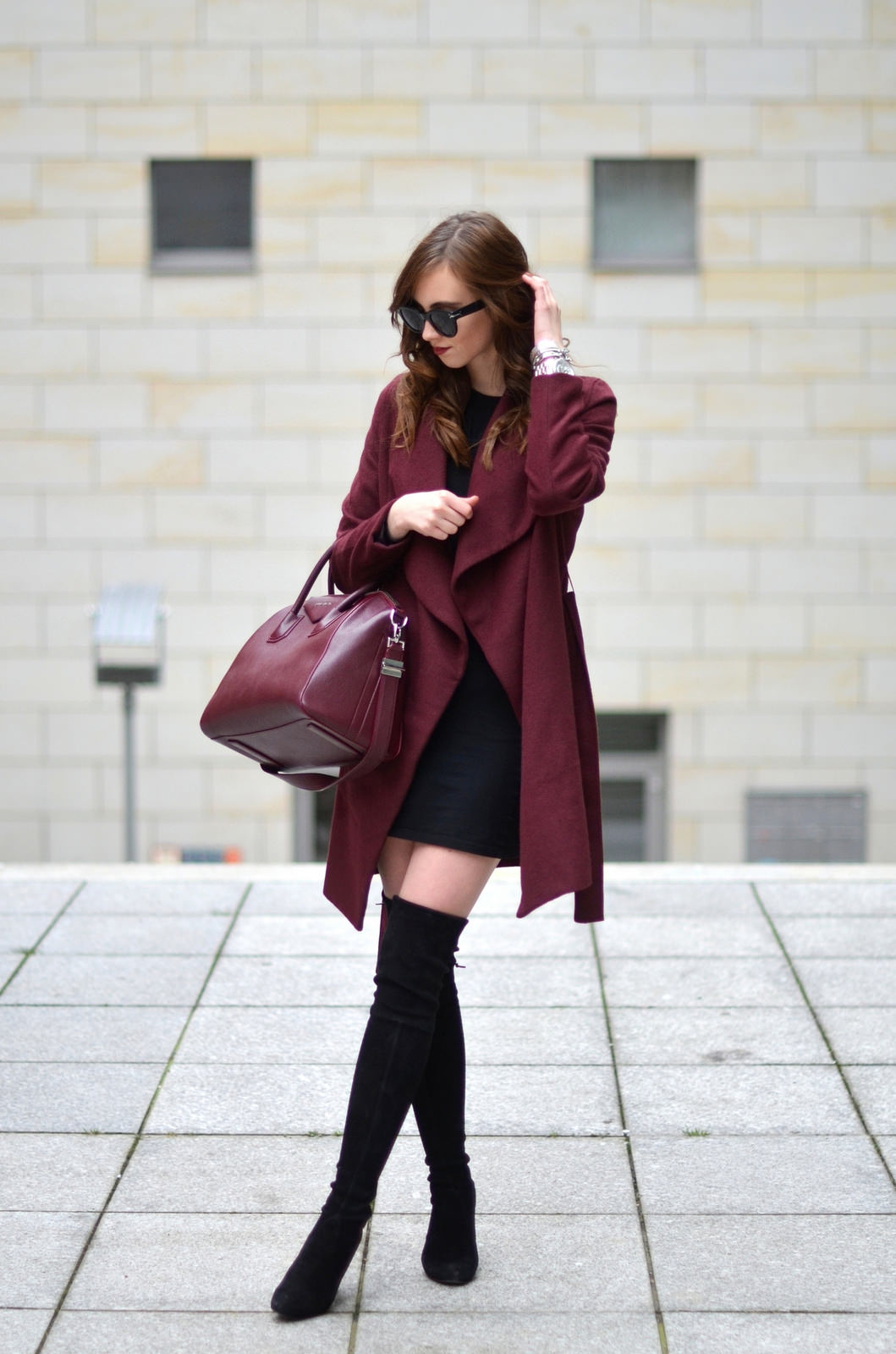 Barbora Ondrackova shows us another way to wear thigh high boots, wearing this pair with a little black dress and a matching burgundy coat and bag. Coat: Medicine, Dress: Zara, Boots: Stuart Weitzman, Bag: Givenchy.
