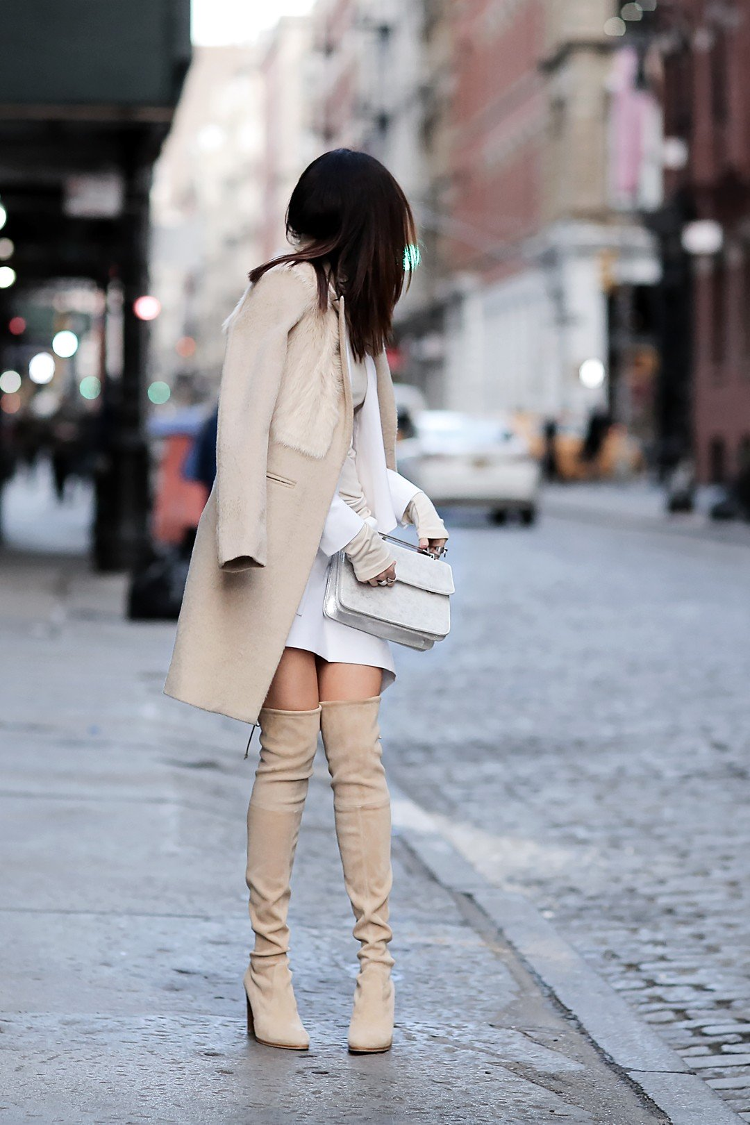 Who said thigh high boots couldn't be in neutral shades? Erica Hoida looks fabulous in these pastel cream coloured boots, worn with a matching overcoat and fur collar. Coat: Mason, Blazer: Marissa Webb, Shirt: Rachel Pally, Skirt: Marissa Webb Boots: Stuart Weitzman, Bag: M2Malletier.