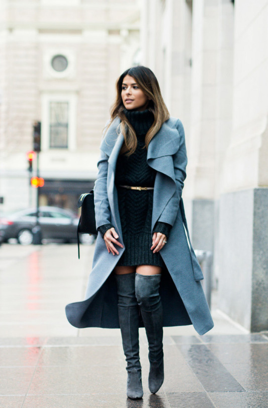 Pam Hetlinger is wearing thigh high boots with a gorgeous pale blue maxi coat and a cute cable knit sweater dress. Wearing a mini belt around a dress like this will clinch your waist and accentuate your curves! Coat: Missguided, Dress: Asos, Boots: Stuart Weitzman.