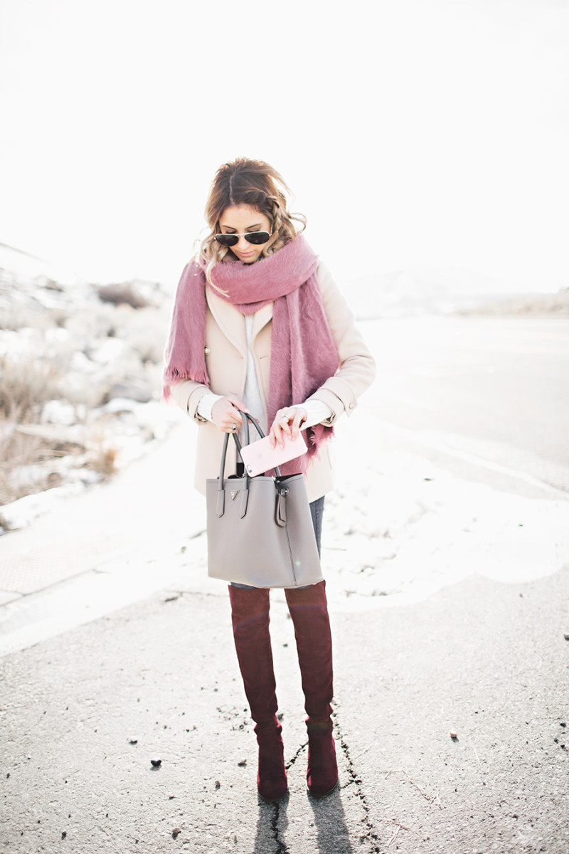 Wear thigh high boots in various colours to freshen up your every day look! Emily Jackson is rocking these burgundy boots, which she is wearing with jeans, a cute pink coat, and a matching scarf. Coat/Sweater: J.Crew, Boots: Stuart Weitzman, Bag: Prada bag, Jeans: Rag and Bone, Scarf: Free People.