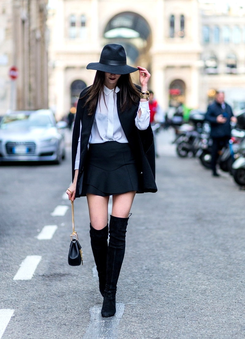 We are loving Barbora Ondrackova's sophisticated yet edgy winter style! Pair black thigh high boots with a white shirt, black mini skirt and sleeveless cape to steal this awesome style! Cape: Missguided, Shirt: Zara, Skirt/Hat: Topshop, Boots: Stuart Weitzman, Bag: Chloé.
