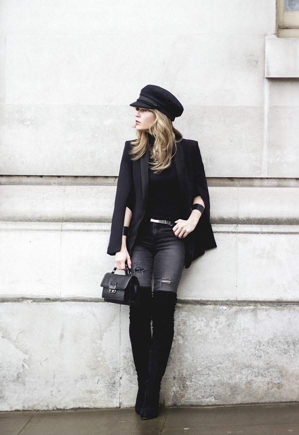 We are loving Isabel Sellés' thigh high boots outfit, which consists of patent black boots, distressed grey jeans, a mini belt, and a fitted blazer/peaked cap combination. Jeans/Cape Blazer: H&M, Boots: Asos, Sweater: Massimo Dutti, Bag: Mango.