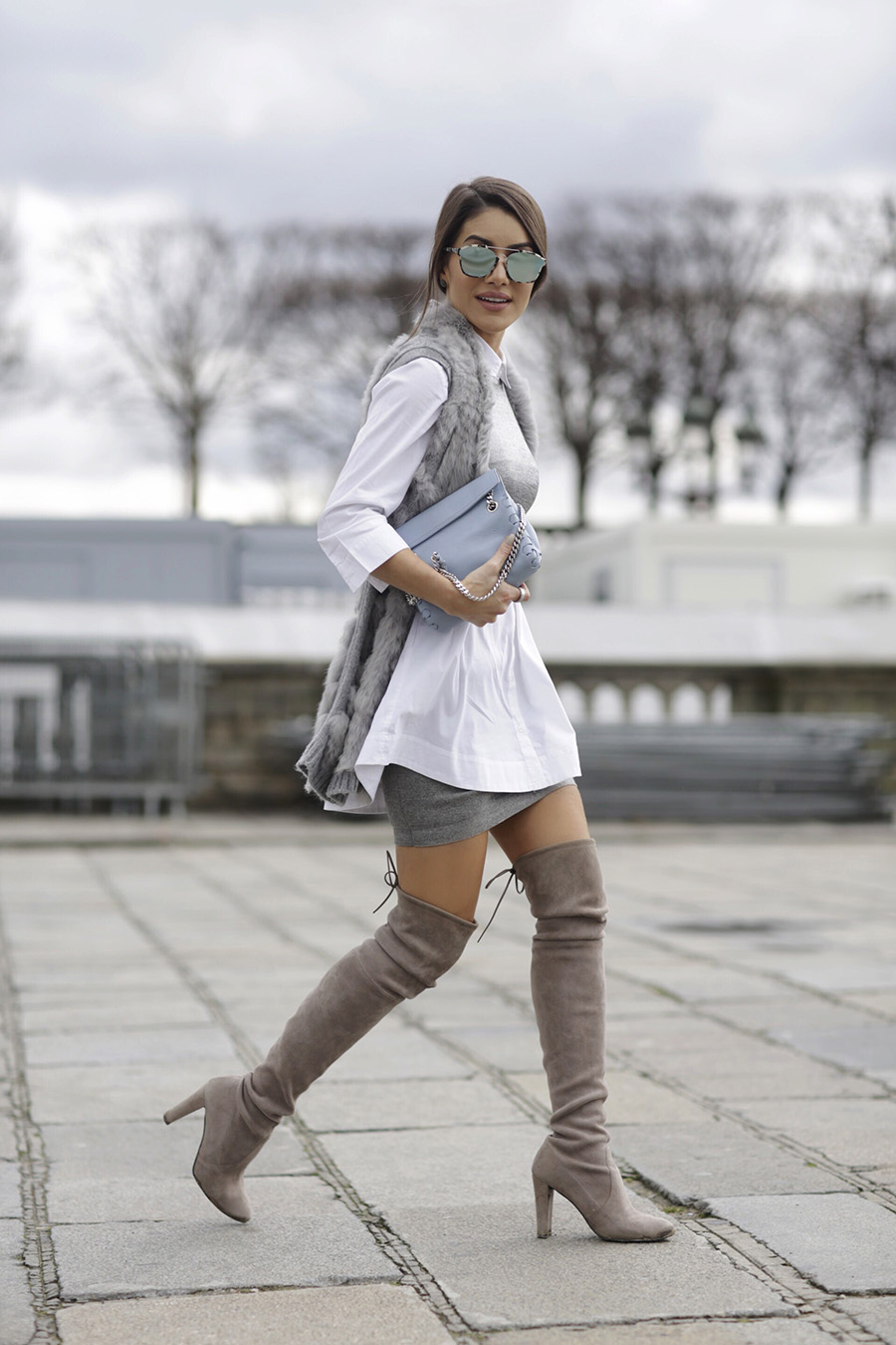 Coordinating your thigh high boots with the rest of your outfit is essential in achieving a high class, sophisticated style. Camila Coelho has got the right idea, pairing a grey vest with a matching mini skirt and boots. Shirt: Topshop, Top: Glória Coelho, Boots: Stuart Weitzman.