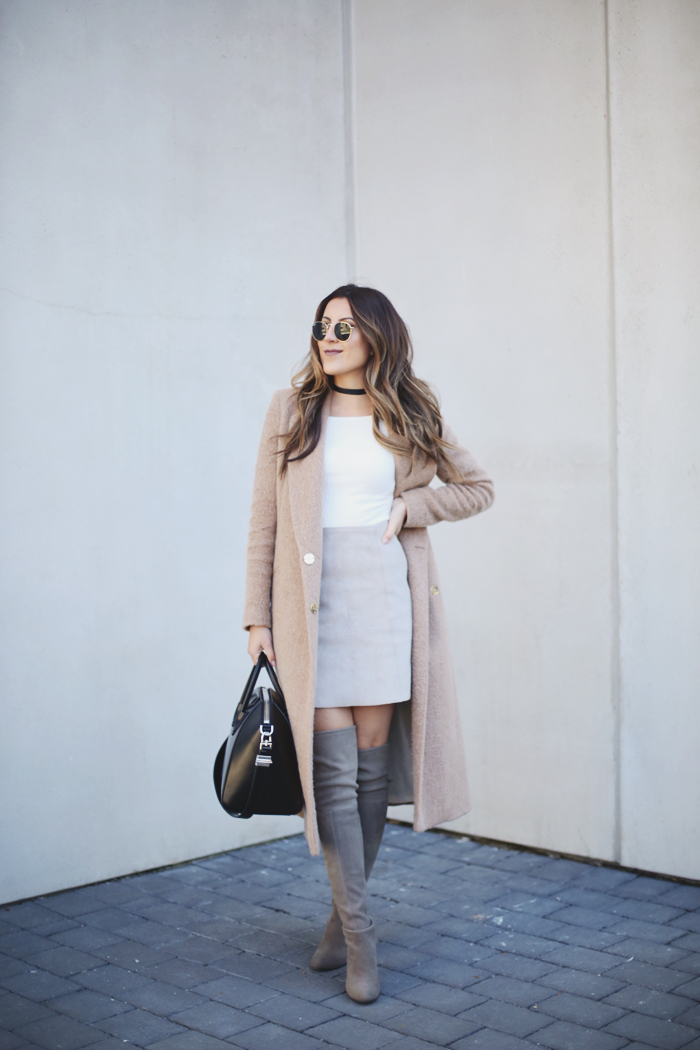 Stephanie Sterjovski is combining multiple trends here, wearing neutral shades and pastel coloured boots. We love this look for a sophisticated every day style. Coat: River Island, Top: H&M, Skirt: Artizia, Boots: Stuart Weitzman, Bag: Givenchy.