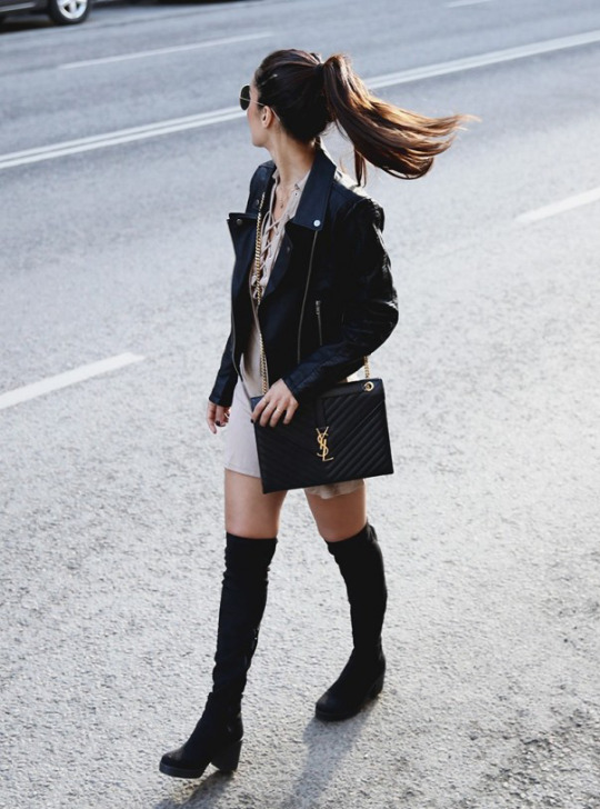 Chunky-soled thigh thigh boots are a trend! Sharareh Sophia Hosseini is rocking this pair of black boots, wearing them with a beige lace up mini dress and a sleek leather jacket. Dress: Nelly, Shoes: Din sko, Purse: YSL, Jacket: Lisa Olsson for NLYtrend, Sunnies: Rayban.
